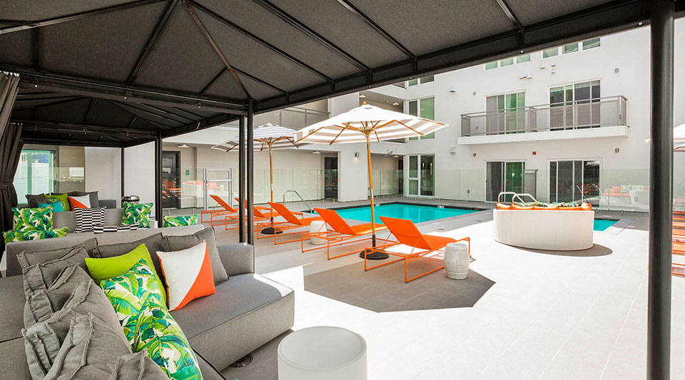 Luxury Apartments in Glendale, CA - ONYX Glendale Swimming Pool Surrounded by Shaded Lounge Seating and Cabanas
