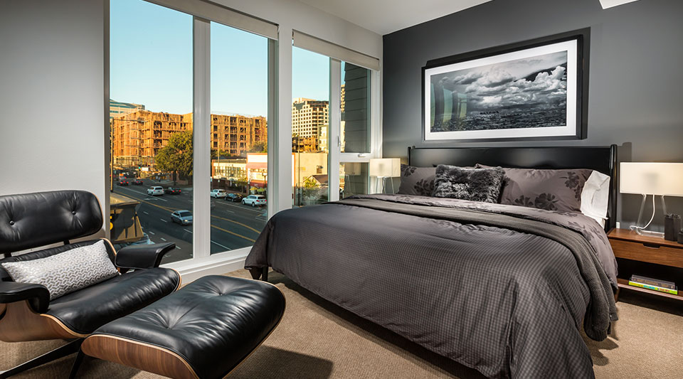 Three Bedroom Apartments in Glendale, CA - ONYX Glendale Spacious Bedroom with Floor-to-Ceiling Windows and Carpet Flooring