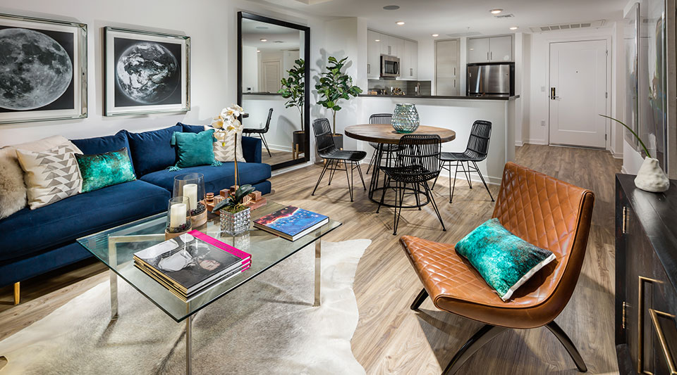 Glendale, CA Apartments - ONYX Glendale Open-Concept Living Room with Hardwood-Style Flooring Next to Dining Area